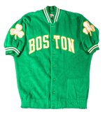 This photo provided by Hunt Auctions, shows a Boston Celtics NBA basketball jacket owned by Celtics player and coach, Bill Russell. The most-decorated man in NBA history will soon be giving the public a chance to own some of the prized artifacts from his legendary basketball career. Hall of Famer Bill Russell announced, Thursday, July 22, 2021, that he is offering hundreds of items from his personal collection including trophies, rings, basketballs, jerseys, letters, photos, and other memorabilia at auction. (Mike Freeberg/Hunt Auctions via AP)