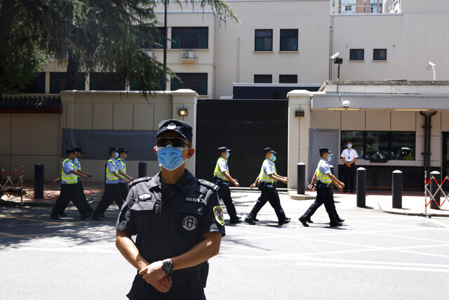 Chinese policemen march past the former United States Consulate in Chengdu in southwest China's Sichuan province on Monday, July 27, 2020. Chinese authorities took control of the former U.S. consulate in the southwestern Chinese city on Monday after it was ordered closed amid rising tensions between the global powers. (AP Photo/Ng Han Guan)