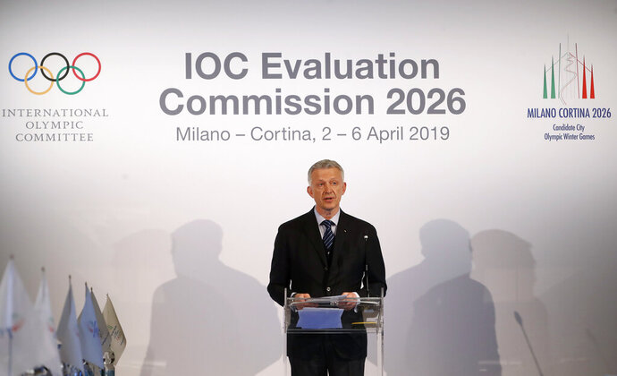 FILE - In this Friday, April 5, 2019 file photo, Winter Olympics Milano Cortina bid IOC Evaluation Commission manager Octavian Morariu talks during an IOC Evaluation Commission meeting, in Milan, Italy. The Italian bid to host the 2026 Winter Olympics in Milan and Cortina d'Ampezzo looks stronger than the Stockholm-Are project in an IOC analysis of the candidates. The IOC says its own polling in March showed