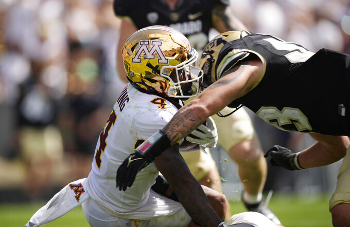 Minnesota running back Mar'Keise Irving, left, is tackled by Colorado linebacker Nate Landman in the second half of an NCAA college football game Saturday, Sept. 18, 2021, in Boulder, Colo. Minnesota won 30-0. (AP Photo/David Zalubowski)