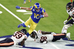 Los Angeles Rams wide receiver Cooper Kupp, top, leaps over Chicago Bears inside linebacker Danny Trevathan (59) and inside linebacker Roquan Smith (58) during the second half of an NFL football game Monday, Oct. 26, 2020, in Inglewood, Calif. (AP Photo/Ashley Landis )