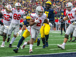 Ohio State running back J.K. Dobbins (2) scores a touchdown in the second quarter of an NCAA college football game against Michigan in Ann Arbor, Mich., Saturday, Nov. 30, 2019. (AP Photo/Tony Ding)
