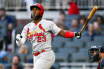 St. Louis Cardinals' Marcell Ozuna watches his three-run home run during the first inning of the team's baseball game against the Atlanta Braves, Tuesday, May 14, 2019, in Atlanta. (AP Photo/John Amis)