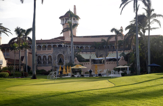FILE - In this Nov. 24, 2017 file photo shows President Donald Trump's Mar-a-Lago resort in Palm Beach, Fla. President Trump's Mar-a-Lago club will partially reopen to members this weekend as South Florida slowly reopens from the coronavirus lock down. An email sent Thursday, May 14, 2020 to members says the Palm Beach resort's Beach Club restaurant, its pool and its whirlpool will reopen Saturday after being closed two months, but its main building that includes hotel rooms, the main dining area and the president's private residence will remain closed. (AP Photo/Alex Brandon, File)