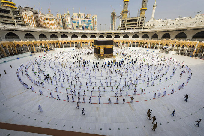 FILE - In this July 31, 2020, file photo, pilgrims walk around the Kabba at the Grand Mosque in the Muslim holy city of Mecca, Saudi Arabia. Saudi Arabia said Saturday, July 12, 2021, that this year's hajj pilgrimage will be limited to no more than 60,000 people, all of them from within the kingdom, due to the ongoing coronavirus pandemic. (Saudi Ministry of Media via AP, File)