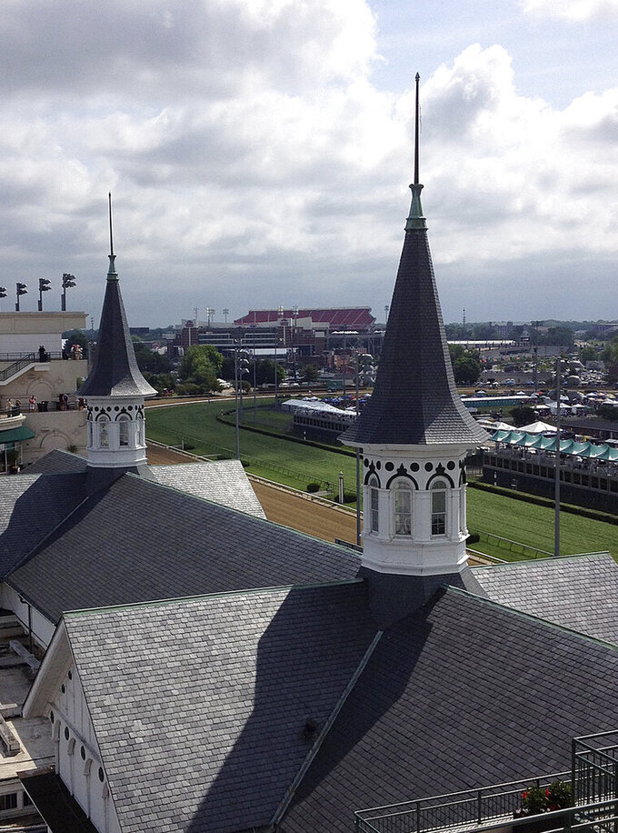 FILE - In this May 5, 2012, file photo, the  twin spires at Churchill Downs are shown in Louisville, Ky. Churchill Downs has delayed reopening stables at the track and training center to April 28 and postponed its spring meet that was scheduled to open April 25. (AP Photo/Janet Cappiello, File)