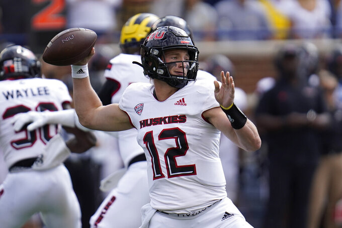 Northern Illinois quarterback Rocky Lombardi (12) throws against Michigan in the first half of a NCAA college football game in Ann Arbor, Mich., Saturday, Sept. 18, 2021. (AP Photo/Paul Sancya)