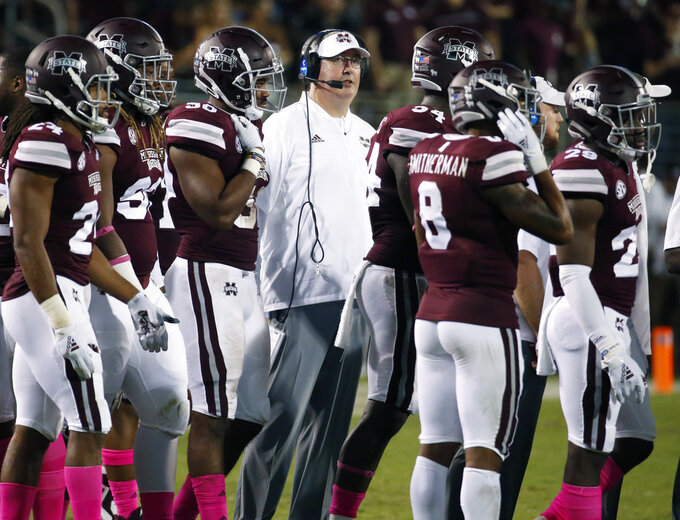 FILE - In this Saturday, Oct. 6, 2018, file photo, Mississippi State coach Joe Moorhead stands with his team during a timeout in the second half of their NCAA college football game against Auburn in Starkville, Miss. The SEC this week has been able to celebrate having the highest number of ranked teams within a single conference at any time in the past two years. Mississippi State went from unranked to 24th after defeating Auburn, which plummeted to 21st. (AP Photo/Rogelio V. Solis, File)