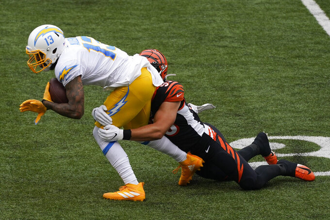 Los Angeles Chargers' Keenan Allen (13) is tackled by Cincinnati Bengals' Logan Wilson (55) during the first half of an NFL football game, Sunday, Sept. 13, 2020, in Cincinnati. (AP Photo/Darron Cummings)