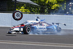 Graham Rahal hits the wall in Turn 2 after losing a tire during the Indianapolis 500 auto race at Indianapolis Motor Speedway in Indianapolis, Sunday, May 30, 2021. (AP Photo/Rob Baker)