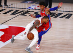 Portland Trail Blazers' Damian Lillard drives against Philadelphia 76ers' Matisse Thybulle during the fourth quarter of an NBA basketball game Sunday, Aug. 9, 2020, in Lake Buena Vista, Fla. (Kevin C. Cox/Pool Photo via AP)