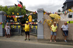 Spectators stand along the road during the fourteenth stage of the Tour de France cycling race over 117,5 kilometers (73 miles) with start in Tarbes and finish at the Tourmalet pass, France, Saturday, July 20, 2019. (AP Photo/ Christophe Ena)