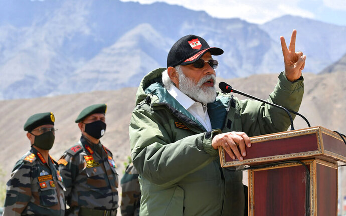In this handout photo provided by the Press Information Bureau, Indian Prime Minister Narendra Modi adresses soldiers during a visit to Nimu, Ladakh area, India, Friday, July 3, 2020. Modi made an unannounced visit Friday to a military base in remote Ladakh region bordering China where the soldiers of the two countries have been facing off for nearly two months. Modi's visit comes in the backdrop of massive Indian army build-up in Ladakh region following hand-to-hand combat between Indian and Chinese soldiers on June 15 that left 20 Indian soldiers dead and dozens injured, the worst military confrontation in over four decades between the Asian giants. (Press Information Bureau via AP)