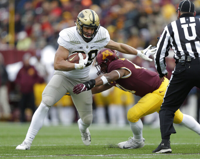 Purdue tight end Brycen Hopkins runs after a catch and is tackled by Minnesota defensive back Thomas Barber (41) during the first quarter against Minnesota in a NCAA college football game Saturday, Nov. 10, 2018, in Minneapolis. (AP Photo/Andy Clayton-King)