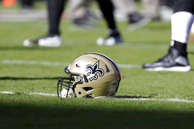 FILE - In this Oct. 23, 2016, file photo, a New Orleans Saints helmet rests on the playing field before an NFL football game in Kansas City, Mo. The Saints are going to court to keep the public from seeing hundreds of emails that allegedly show team executives doing public relations damage control for the area's Roman Catholic archdiocese to help it contain the fallout from a burgeoning sexual abuse crisis. (AP Photo/Jeff Roberson, File)
