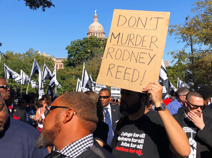 Supporters rally to stop the execution of Texas death row inmate Rodney Reed outside the governor's mansion in Austin, Texas, Saturday, Nov. 9, 2019. In his five years as Texas' governor, Republican Greg Abbott has overseen the execution of nearly 50 prisoners while only once sparing a condemned man's life, after a victims' family asked him to do so. (AP Photo/Paul Weber)