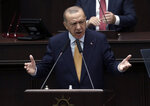 Turkey's President Recep Tayyip Erdogan addresses his ruling party lawmakers at the parliament, in Ankara, Turkey, Wednesday, Oct. 28, 2020. Turkish officials on Wednesday railed against French satirical magazine Charlie Hebdo over its cover-page cartoon mocking Turkish President Recep Tayyip Erdogan and accused it of sowing