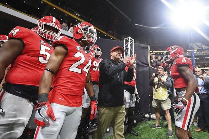FILE - In this Jan. 8, 2018, file photo, Georgia head coach Kirby Smart and his players prepare to take the field before the College Football Playoff National Championship game against Alabama in Atlanta. Saturday's SEC Championship, is the game the Bulldogs have wanted since last January, when the Alabama pulled out a 26-23 overtime victory in the national championship game. (AJ Reynolds/Athens Banner-Herald via AP, File)