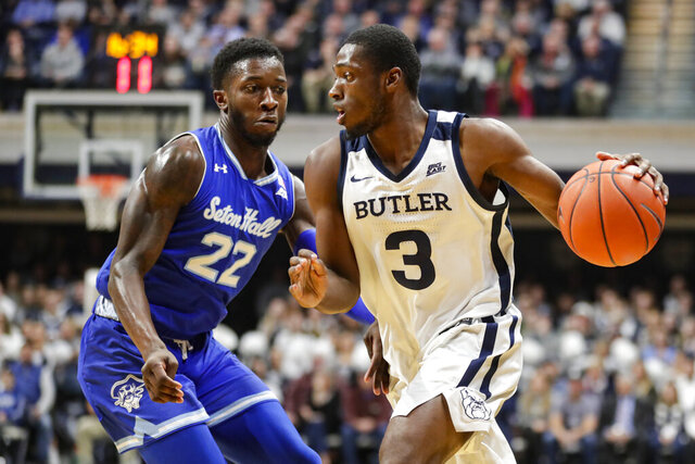 Butler guard Kamar Baldwin (3) drives on Seton Hall guard Myles Cale (22) in the first half of an NCAA college basketball game in Indianapolis, Wednesday, Jan. 15, 2020. (AP Photo/Michael Conroy)