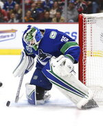 CORRECTS SPELLING TO DEMKO, INSTEAD OF DEMO - Vancouver Canucks goalie Thatcher Demko makes a save against the Detroit Red Wings during the first period of an NHL hockey game Tuesday, Oct. 15, 2019, in Vancouver, British Columbia. (Ben Nelms/The Canadian Press via AP)
