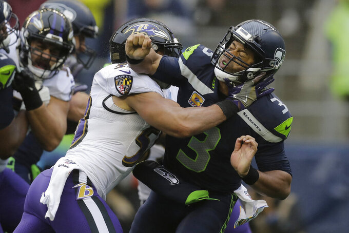 After weeks of magic Wilson, Seahawks falter vs. Ravens