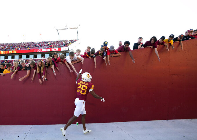 Iowa State defensive back Anthony Johnson Jr. (26) high-fives fans after the team's 16-10 win over Northern Iowa in an NCAA college football game, Saturday, Sept. 4, 2021, in Ames, Iowa. (AP Photo/Matthew Putney)
