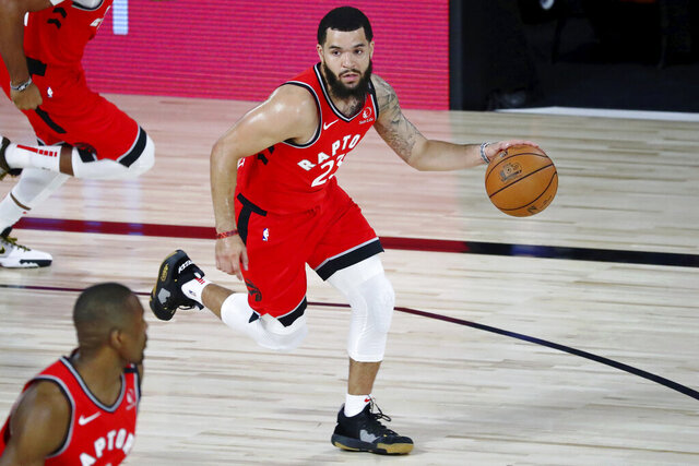 Toronto Raptors guard Fred VanVleet (23) dribbles up the court against the Brooklyn Nets during the first half of Game 3 of an NBA basketball first-round playoff series, Friday, Aug. 21, 2020, in Lake Buena Vista, Fla. (Kim Klement/Pool Photo via AP)