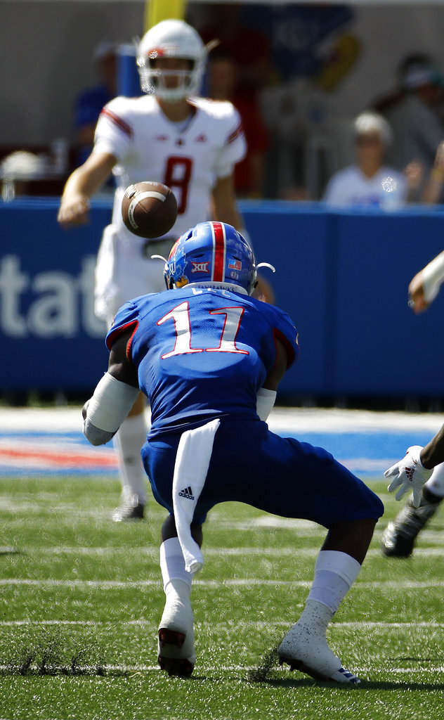 Kansas safety Mike Lee (11) intercepts a pass thrown by Rutgers quarterback Artur Sitkowski (8) before returning it for a touchdown during the first half of an NCAA college football game Saturday, Sept. 15, 2018, in Lawrence. (AP Photo/Charlie Riedel)