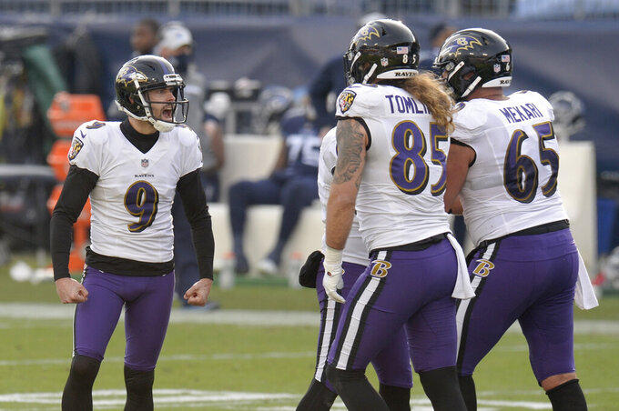 Baltimore Ravens kicker Justin Tucker (9) celebrates after kicking a 51-yard field goal against the Tennessee Titans in the second half of an NFL wild-card playoff football game Sunday, Jan. 10, 2021, in Nashville, Tenn. (AP Photo/Mark Zaleski)