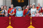 FILE - In this Saturday, June 9, 2018 file photo, from left, Britain's Princess Anne, Princess Beatrice, Prince Andrew, Queen Elizabeth, Meghan, Duchess of Sussex, Prince Charles, Prince Harry, Kate, Duchess of Cambridge and Prince William attend the annual Trooping the Colour Ceremony in London. Sunday, May 19, 2019 marks the first wedding anniversary of Prince Harry and his wife Meghan, the Duchess of Sussex. (AP Photo/Frank Augstein, File)