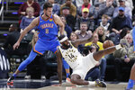 Indiana Pacers forward JaKarr Sampson (14) loses the ball in front of Oklahoma City Thunder forward Danilo Gallinari (8) during the first half of an NBA basketball game in Indianapolis, Tuesday, Nov. 12, 2019. (AP Photo/Michael Conroy)