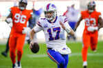FILE - Buffalo Bills quarterback Josh Allen (17) runs against the Denver Broncos during an NFL football game in Denver, in this Saturday, Dec. 19, 2020, file photo. Buffalo's Josh Allen and Baltimore's Lamar Jackson become the first quarterbacks of the five-member 2018 first-round draft class set to meet in the playoffs as the Bills prepare to face the Ravens in the AFC divisional round on Saturday night.(AP Photo/Jack Dempsey, File)