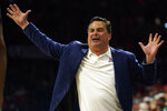 Arizona coach Sean Miller reacts to a foul call during the second half of the team's NCAA college basketball game against Washington on Saturday, March 7, 2020, in Tucson, Ariz. Washington won 69-63. (AP Photo/Rick Scuteri)