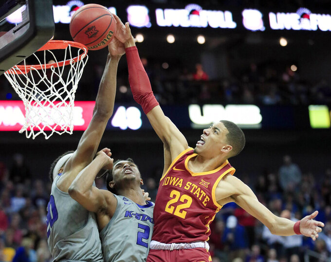 Iowa State guard Tyrese Haliburton (22) dunks over Kansas State forward Xavier Sneed, left, and guard Cartier Diarra (2) during the second half of an NCAA college basketball game in the semifinals of the Big 12 conference tournament in Kansas City, Mo., Friday, March 15, 2019. Iowa State won 63-59. (AP Photo/Orlin Wagner)