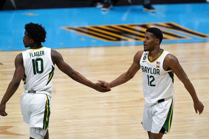 Baylor guard Jared Butler (12) celebrates with teammate guard Adam Flagler (10) during the first half of a men's Final Four NCAA college basketball tournament semifinal game against Houston, Saturday, April 3, 2021, at Lucas Oil Stadium in Indianapolis. (AP Photo/Michael Conroy)