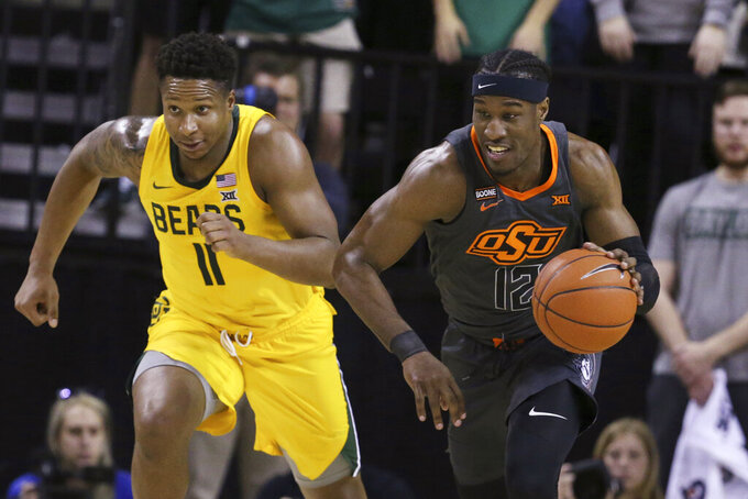 Oklahoma State forward Cameron McGriff, right, heads upcourt past Baylor guard Mark Vital, left, after a turnover during the first half of an NCAA college basketball game Saturday, Feb. 8, 2020, in Waco, Texas. (AP Photo/Rod Aydelotte)