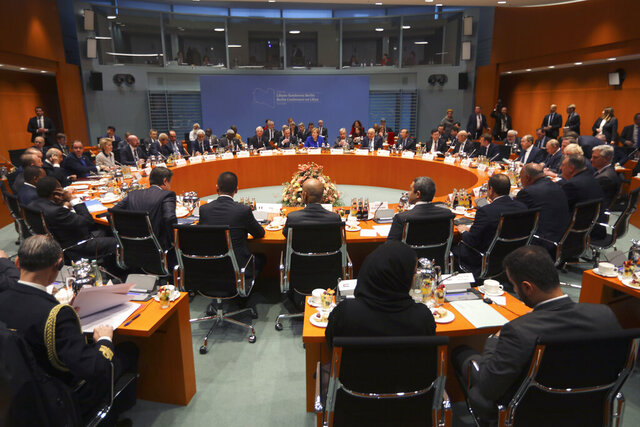 German Chancellor Angela Merkel, rear center, leads a conference on Libya at the chancellery in Berlin, Germany, Sunday, Jan. 19, 2020. (Hannibal Hanschke/Pool Photo via AP)