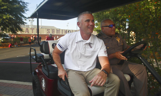 Florida State head coach Mike Norvell arrives before an NCAA college football game against Notre Dame, Sunday, Sept. 5, 2021, in Tallahassee, Fla. (AP Photo/Phil Sears)