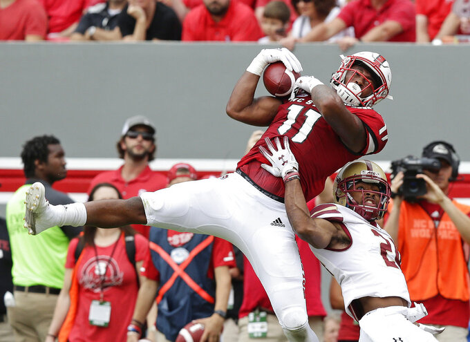 North Carolina State's Jakobi Meyers (11) catches a pass while Boston College's Taj-Amir Torres (24) defends during the first half an NCAA college football game in Raleigh, N.C., Saturday, Oct. 6, 2018. (AP Photo/Gerry Broome)