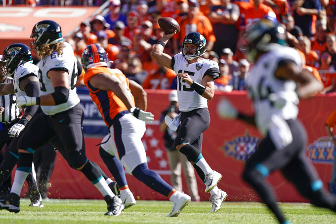 Jacksonville Jaguars quarterback Gardner Minshew, second from high scrambles during the first half of an NFL football game against the Denver Broncos, Sunday, Sept. 29, 2019, in Denver. (AP Photo/Jack Dempsey)