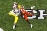 LSU tight end Thaddeus Moss catches a pass over Clemson cornerback Derion Kendrick during the first half of a NCAA College Football Playoff national championship game Monday, Jan. 13, 2020, in New Orleans. (AP Photo/Eric Gay)