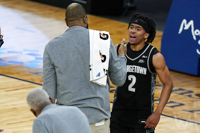 Georgetown's Dante Harris (2) celebrates with coach Patrick Ewing after the team's NCAA college basketball game against Seton Hall in the semifinals in the Big East men's tournament Friday, March 12, 2021, in New York. Georgetown won 66-58. (AP Photo/Frank Franklin II)