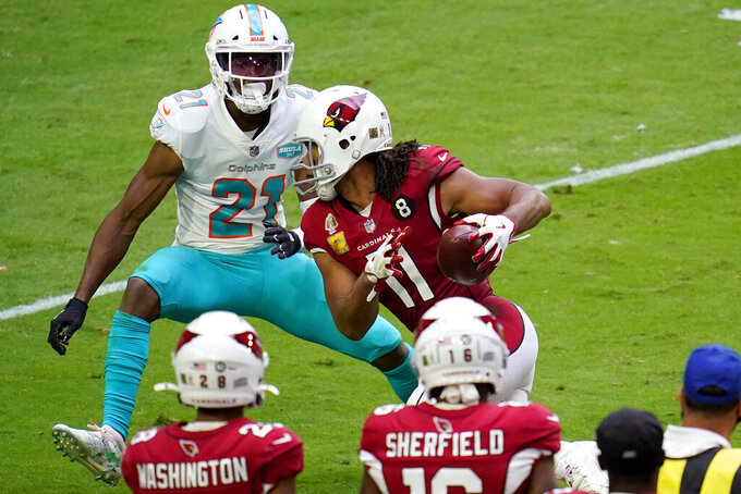 Arizona Cardinals wide receiver Larry Fitzgerald (11) runs the ball after the catch as Miami Dolphins free safety Eric Rowe (21) defends during the first half of an NFL football game, Sunday, Nov. 8, 2020, in Glendale, Ariz. (AP Photo/Ross D. Franklin)