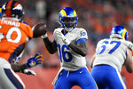 Los Angeles Rams quarterback Bryce Perkins (16) throws against the Denver Broncos during the first half of an NFL preseason football game, Saturday, Aug. 28, 2021, in Denver. (AP Photo/David Zalubowski)