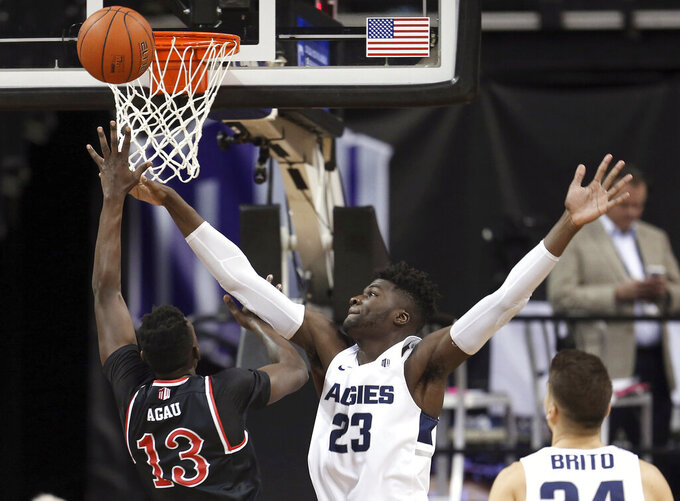 Fresno State's Aguir Agau (13) shoots as Utah State's Neemias Queta (23) defends during the first half of an NCAA college basketball game in the Mountain West Conference men's tournament Friday, March 15, 2019, in Las Vegas. (AP Photo/Isaac Brekken)