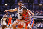 Butler forward Bryce Golden (33) defends Florida forward Kerry Blackshear Jr. (24) in the second half of an NCAA college basketball game in Indianapolis, Saturday, Dec. 7, 2019. Butler defeated Florida 76-62. (AP Photo/Michael Conroy)