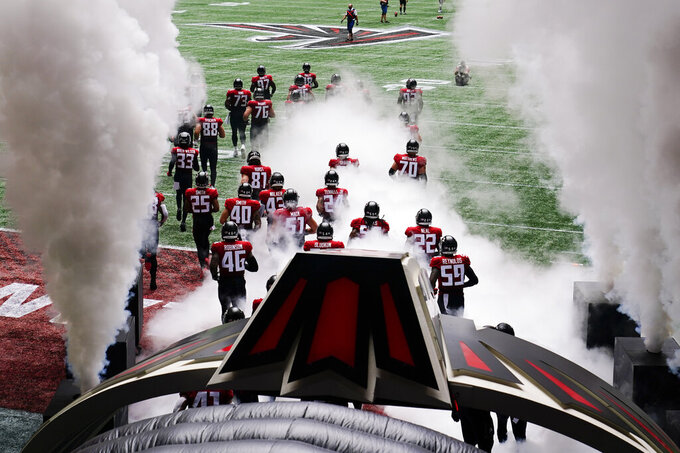 Atlanta Falcons take the field before the first half of an NFL football game between the Atlanta Falcons and the Detroit Lions, Sunday, Oct. 25, 2020, in Atlanta. (AP Photo/Brynn Anderson)