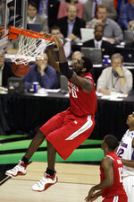 FILE - In this April 2, 2007, file photo, Ohio State center Greg Oden dunks against Florida during the NCAA Final Four basketball championship game at the Georgia Dome in Atlanta. The 7-footer averaged 15.7 points, 9.6 rebounds and 3.3 blocks for Ohio State before the Portland Trail Blazers took him with the No. 1 pick in the 2007 draft. (AP Photo/Morry Gash, File)