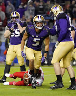 Washington defensive back Myles Bryant (5) celebrates with teammates after sacking Utah quarterback Jason Shelley, bottom, during the first half of the Pac-12 Conference championship NCAA college football game in Santa Clara, Calif., Friday, Nov. 30, 2018. (AP Photo/Tony Avelar)