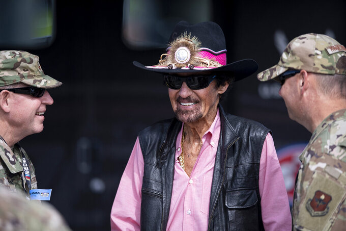 Richard Petty speaks to military service prior to a NASCAR Cup Series auto racing race at Charlotte Motor Speedway, Monday, Oct. 11, 2021, in Concord, N.C. (AP Photo/Matt Kelley)